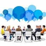 Diverse People in Meeting With Speech Bubbles
